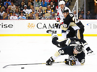 Adam Clendening #2 of the Pittsburgh Penguins falls to the ice following a hooking penalty against the Washington Capitals in the third period during the game at Consol Energy Center in Pittsburgh, Pennsylvania on December 14, 2015. (Photo by Jared Wickerham / DKPS)