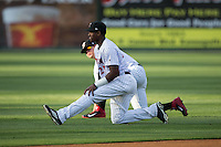 Micker Adolfo (front) and Corey Zangari (14) stretch prior to the game against the Delmarva Shorebirds at Kannapolis Intimidators Stadium on April 21, 2016 in Kannapolis, North Carolina.  The Intimidators defeated the Shorebirds 9-3.  (Brian Westerholt/Four Seam Images)