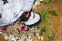 Diana R., who claims to be possessed by spirits, cries during a ritual of exorcism performed by Hermes Cifuentes in La Cumbre, Colombia, 28 May 2012. Exorcism is an ancient religious practice of evicting spirits, generally called demons or evil. Although the formal catholic rite of exorcism is rarely seen and must be only conducted by a designated priest, there are many pastors and preachers in Latin America performing exorcism ceremonies. The 52-year-old Brother Hermes, as the exorcist calls himself, claims to have been carrying out the healing rituals for more than 20 years. Using fire, dirt, candles, flowers, eggs and other natural-based items, in conjunction with Christian religous formulas, he attempts to drive the supposed evil spirit out of a victim's mind and body.