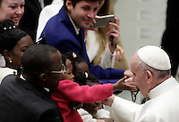 Papa Francesco saluta i bambini al termine dell'Udienza Generale del mercoledi' in aula Paolo VI, Citta' del Vaticano, 4 gennaio 2017.<br /> Pope Francis greets children at the end of his weekly general audience in Paul VI Hall at the Vaticanon January 4, 2017.<br /> UPDATE IMAGES PRESS/Isabella Bonotto<br /> <br /> STRICTLY ONLY FOR EDITORIAL USE