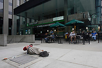 Toronto (ON) CANADA,  April , 2008-.Homless man on the sidewalk beside a STARBUCK (tm) downtown....