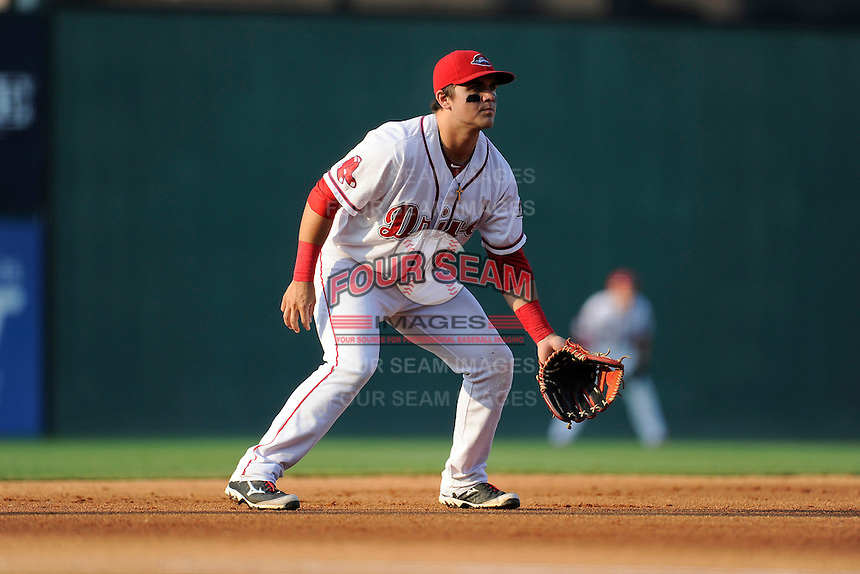 Third baseman Michael Chavis (11) of the Greenville Drive plays defense in a game against the Charleston RiverDogs on Monday, June 29, 2015, at Fluor Field at the West End in Greenville, South Carolina. Chavis was a first-round pick of the Boston Red Sox in the 2014 First-Year Player Draft. Greenville won, 4-2. (Tom Priddy/Four Seam Images)
