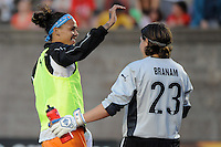 Natasha Kai (6) of Sky Blue FC celebrates after the game with goalkeeper Jenni Branam (23). Sky Blue FC defeated the Boston Breakers 2-1 during a WPS regular season match at Harvard Stadium in Boston, MA, on July 12, 2009.
