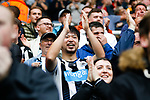 A Newcastle fan wearing a neck mounted go-pro type camera celebrates the fifth minute goal scored by Callum Wilson. Newcastle v West Ham, August 15th 2021. The first game of the season, and the first time fans were allowed into St James Park since the Coronavirus pandemic. 50,673 people watched West Ham come from behind twice to secure a 2-4 win.