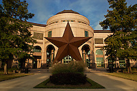 """The Bob Bullock Texas State History Museum in downtown Austin, Texas, tells the """"Story of Texas"""" with three floors of interactive exhibits, the special effects show, The Star of Destiny, in the Texas Spirit Theater, and Austin's only IMAX Theatre, featuring the signature large-format film, Texas: The Big Picture. A 35-foot-tall bronze Lone Star sculpture greets visitors in front of the Museum, and a colorful terrazzo floor in the Museum's rotunda features a campfire scene with enduring themes from Texas' past. The Museum also has a Cafe with indoor and outdoor seating and a Museum Store with something for the Texan in everyone."""