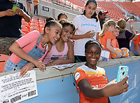 Houston, TX - Saturday May 27, 2017: Nichelle Prince takes a selfie with Houston Dash fans after a regular season National Women's Soccer League (NWSL) match between the Houston Dash and the Seattle Reign FC at BBVA Compass Stadium.