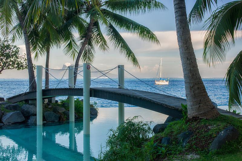 Bridge over infinity pool at the Intercontinental Tahiti hotel. Tahiti. French Polynesia