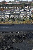 Terraced housing next to the bulldozed site of a demolished colliery in the village of Treharris, South Wales