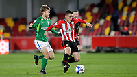 Sergi Canos of Brentford in action as Birmingham's Riley McGree looks on during Brentford vs Birmingham City, Sky Bet EFL Championship Football at the Brentford Community Stadium on 6th April 2021