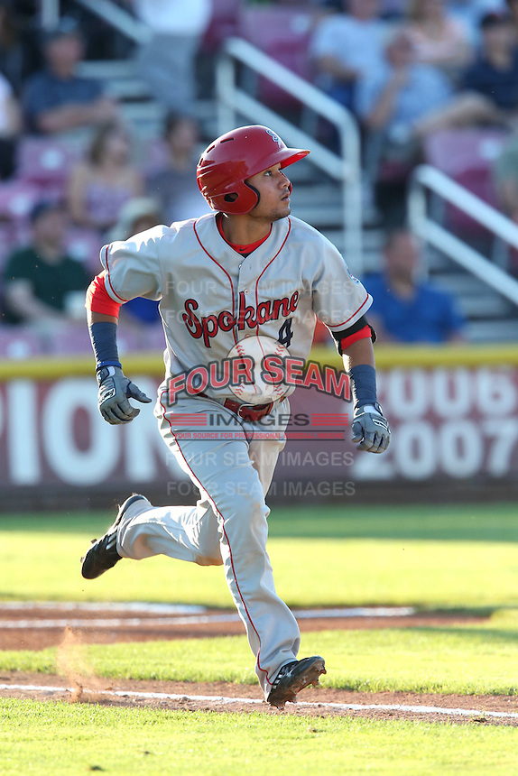 Isiah Kiner-Falefa #4 of the Spokane Indians runs to first base during a game against the Salem-Keizer Volcanoes at Volcanoes Stadium on July 26, 2014 in Keizer, Oregon. Spokane defeated Salem Keizer, 4-1. (Larry Goren/Four Seam Images)
