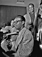 Downbeat: Oscar Moore, Nat King Cole, and Wesley Prince, New York, N.Y., ca. 1946.<br /> <br /> Photo by William Gottlieb.