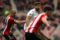 Fernando Llorente of Swansea City (C) is pushed by Darron Gibson of Sunderland during the Premier League match between Sunderland and Swansea City at the Stadium of Light, Sunderland, England, UK. Saturday 13 May 2017