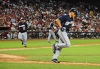 Jun. 30, 2008; Phoenix, AZ, USA; Milwaukee Brewers pinch hitter Gabe Kapler heads to first after being walked with the bases loaded as base runner Prince Fielder heads home to score in the sixth inning against the Arizona Diamondbacks at Chase Field. Mandatory Credit: Mark J. Rebilas-