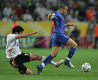 Italian forward (7) Alessandro Del Piero avoids the tackle of German midfielder (13) Michael Ballack.  Italy defeated Germany, 2-0, in overtime in their FIFA World Cup semifinal match at FIFA World Cup Stadium in Dortmund, Germany, July 4, 2006.