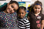 Education Preschool 3-4 year olds portrait of three girls looking at camera two smiling one serious horizontal