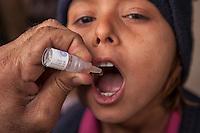 A child receives a polio vaccine in Karachi, Pakistan on Jan. 08, 2014