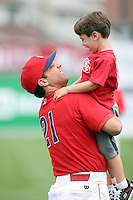 July 4th 2008:  Coach Eric Valent of the Williamsport Crosscutters, Class-A affiliate of the Philadelphia Phillies, and his son during a game at Bowman Field in Williamsport, PA.  Photo by:  Mike Janes/Four Seam Images