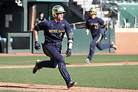 CHAPEL HILL, NC - MARCH 08: Jack Brannigan #9 of the University of Notre Dame drives in Brooks Coetzee #42 during a game between Notre Dame and North Carolina at Boshamer Stadium on March 08, 2020 in Chapel Hill, North Carolina.
