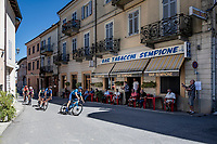 As the breakaway group rolls by at a Bar Tabacchi <br /> <br /> 101st Milano-Torino 2020 (UCI 1.Pro)<br /> 1 day race from Mesero to Stupinigi (198km)