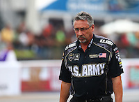 Jun 19, 2015; Bristol, TN, USA; Mike Green , crew chief for NHRA top fuel driver Tony Schumacher (not pictured) during qualifying for the Thunder Valley Nationals at Bristol Dragway. Mandatory Credit: Mark J. Rebilas-
