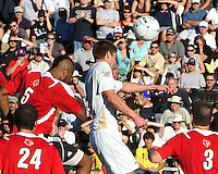 Scott Caldwell #15 of the University of Akron beats Andrew Farrell #5 of the University of Louisville to a header during the 2010 College Cup final at Harder Stadium, on December 12 2010, in Santa Barbara, California. Akron champions, 1-0.
