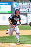 Lansing Lugnuts outfielder Brock Lundquist (33) races home during a Midwest League game against the Wisconsin Timber Rattlers on May 8, 2018 at Fox Cities Stadium in Appleton, Wisconsin. Lansing defeated Wisconsin 11-4. (Brad Krause/Four Seam Images)