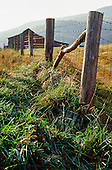 Barn with wire fence on a hill
