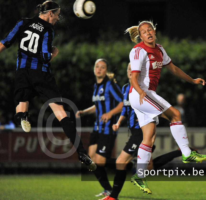 20130830 - VARSENARE , BELGIUM : headingduel pictured between Brugge's Heleen Jaques and Ajax' Mandy Versteegt (right) during the female soccer match between Club Brugge Vrouwen and Ajax Amsterdam Dames , of the first matchday in the BENELEAGUE competition. Friday 30 August 2013. PHOTO DAVID CATRY