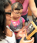 """Sheila Lugo, 13, and Cynthia Medina, 5, looks at a bat skeleton during the NorCal Bats presentation at the Carson City Library on Saturday afternoon. The event was part of the Summer Reading Program, """"Dream Big, Read!"""".Photo by Cathleen Allison"""
