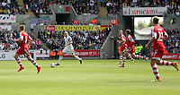 Saturday, 03 May 2014<br /> Pictured: Jonjo Shelvey of Swansea (2nd L_ takes the ball forward.<br /> Re: Barclay's Premier League, Swansea City FC v Southampton at the Liberty Stadium, south Wales.