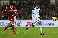 Leroy Fer of Swansea City (R) chased by Emre Can of Liverpool (L) during the Premier League match between Swansea City and Liverpool at The Liberty Stadium, Swansea, Wales, UK. Monday 22 January 2018