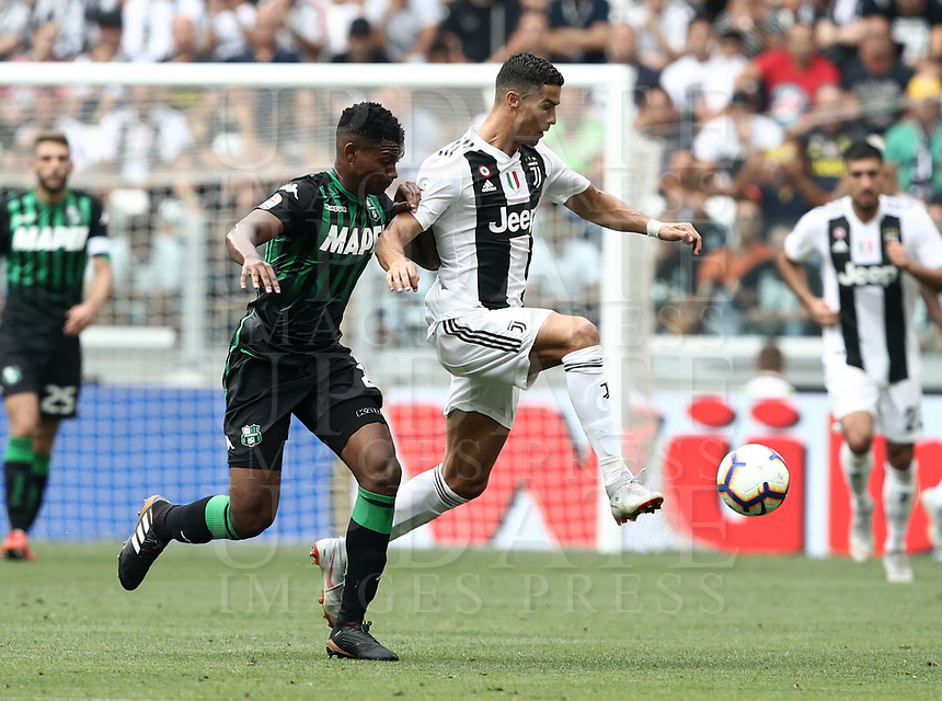 Calcio, Serie A: Juventus - Sassuolo, Turin, Allianz Stadium, September 16, 2018.<br /> Juventus' Cristiano Ronaldo (r) in action with Sassuolo's Marlon (l) during the Italian Serie A football match between Juventus and  Sassuolo at Torino's Allianz stadium, September 16, 2018.<br /> UPDATE IMAGES PRESS/Isabella Bonotto