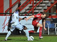 KV Kortrijk - KV Mechelen : Anthonio Ghomsi haalt Brecht Capon (rechts) van de bal.foto VDB / BART VANDENBROUCKE