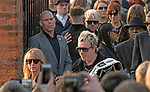 The  funeral of Prodigy singer Keith Flint at St Marys Church in Bocking,  Essex today. Laim Howlett of the Prodigy leaves the service while carrying Keith's belt.