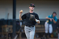 Concord A's third baseman Michael Misenheimer (14) (Lenoir-Rhyne) on defense against the Mooresville Spinners at Moor Park on July 31, 2020 in Mooresville, NC. The Spinners defeated the Athletics 6-3 in a game called after 6 innings due to rain. (Brian Westerholt/Four Seam Images)