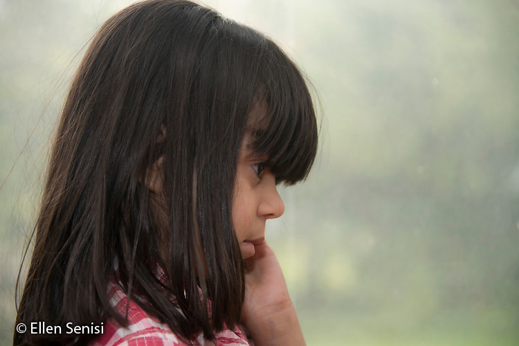 MR / Schenectady, New York. Portrait of young child (girl, 5, Puerto Rican American) looking pensive. ID: Con6. ©Ellen B. Senisi