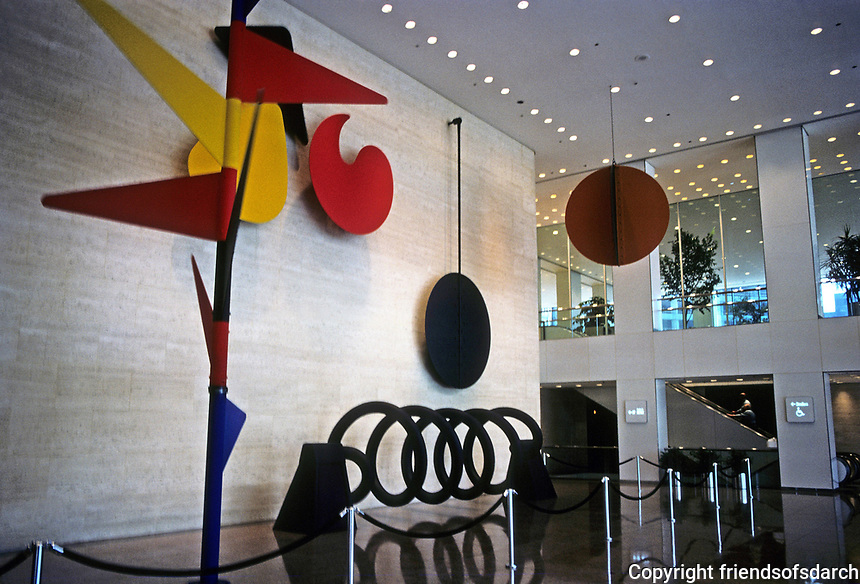 """Chicago: Sears Tower--Alexander Calder Mobile, 1974. """"Universe"""", a """"moving mural"""". Elements are Spine, three flowers, Helix pendulum, and the sun. Photo '88."""