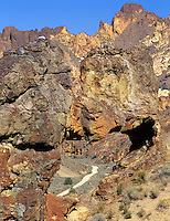 Road in Leslie Gulch as seen through rock arch. Oregon.