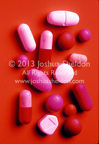 Assorted pills on colorful background<br />