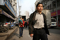 CHINA. Shanghai. Pedestrians in Shanghai. Shanghai is a sprawling metropolis or 15 million people situated in south-east China. It is regarded as the country's showcase in development and modernity in modern China. This rapid development and modernization, never seen before on such a scale has however spawned countless environmental and social problems. 2008