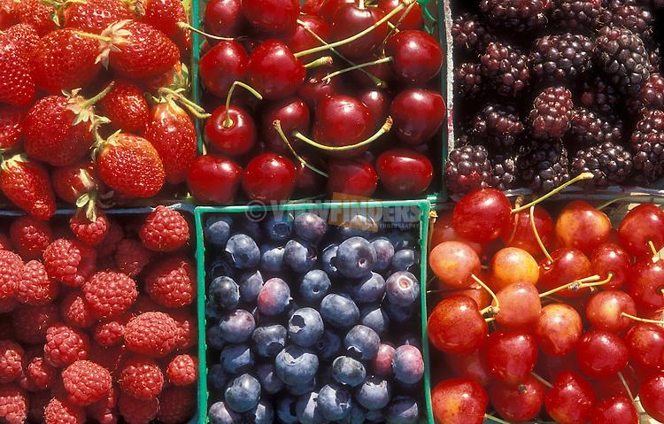 Strawberries, cherries, blackberries, raspberries and blueberries in baskets at produce stand; Willamette Valley, Oregon.