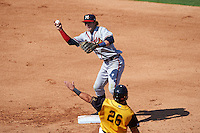 Mississippi Braves shortstop Dansby Swanson (36) barehands a throw from Emerson Landoni (not shown) as Avery Romero (26) slides in during a game against the Jacksonville Suns on May 1, 2016 at The Baseball Grounds in Jacksonville, Florida.  Jacksonville defeated Mississippi 3-1.  (Mike Janes/Four Seam Images)