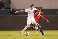 USA's Mixx Diskerud (16) battles Chilean Juan Abarca (30. US Men's National team played the National team of Chile to 1-1 draw at Home Depot Center stadium in Carson, California on Saturday January 22, 2010.
