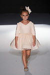 Model walks runway in an outfit from the Little Mademoiselle Spring Summer 2020 runway show for The Society Fashion Week Spring Summer 2020 during New York Fashion Week, on September 7, 2019.