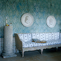 A pair of plaster medallions by Johan Tobias Sergel, a leading Gustavian sculptor, hangs in the dining room