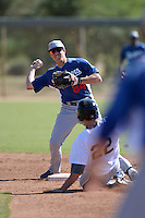 Los Angeles Dodgers infielder Adam Law (84) attempts to turn a double play during an Instructional League game against the Chicago White Sox on October 12, 2013 at Camelback Ranch Complex in Glendale, Arizona.  (Mike Janes/Four Seam Images)