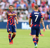 AUSTIN, TX - JULY 29: Cristian Roldan #10 of the United States talks strategy with a teammate during a game between Qatar and USMNT at Q2 Stadium on July 29, 2021 in Austin, Texas.