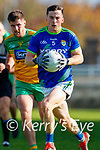Paul Murphy, Kerry in action against Daire Ó Baoill, Donegal and Andrew McClean, Donegal during the Allianz Football League Division 1 Round 7 match between Kerry and Donegal at Austin Stack Park in Tralee on Saturday.