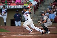 Brian Navarreto (21) of the Cedar Rapids Kernels bats during a game against the Burlington Bees at Veterans Memorial Stadium on June 16, 2015 in Cedar Rapids, Iowa. (Brace Hemmelgarn/Four Seam Images)
