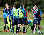 Mark Warburton with his players